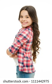 Charming cutie. Kid girl long curly hair posing cheerful happy. Girl curly hairstyle adorable smiling face. Kid happy carefree enjoy childhood. Child charming smile isolated white background.