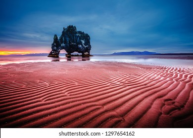 Charming dark sand after the tide. Location famous Hvitserkur rock, Vatnsnes peninsula, Iceland, Europe. Mysterious morning scene. Scenic image of unique place in world. Discover the beauty of earth.