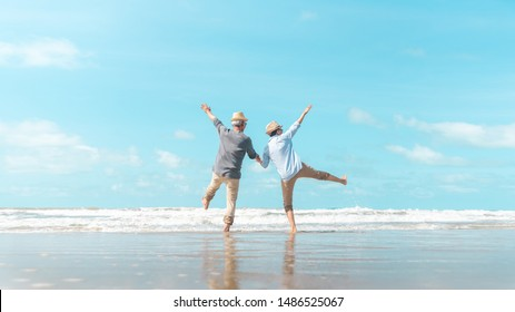 Charming elderly couple went to the beach to enjoy the sea breeze