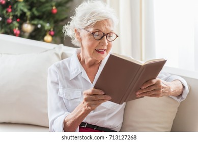 Charming elderly woman is resting at home