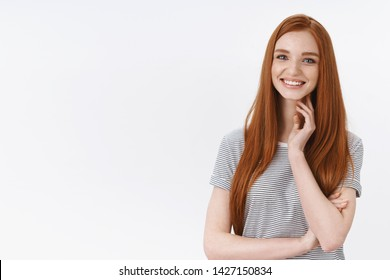Charming elegant cute redhead woman long straight hairstyle touching neck silly blushing smiling camera entertained listen intrigued camera taking part conversation, flirty glance, white background