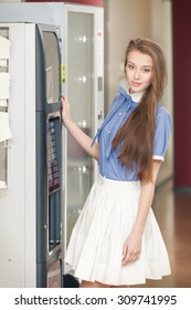 Charming elegant smiling girl with vending machine