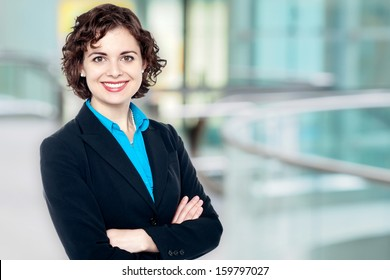 Charming female executive posing confidently