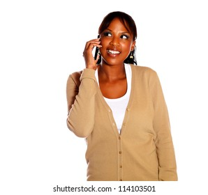 Charming female talking on cellphone against white background