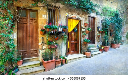 Charming floral decorated streets of medieval towns of Italy. Pitigliano