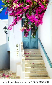 Charming floral streets in sunny Mykonos island. Cyclades, Greece