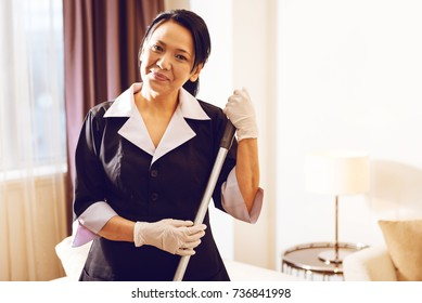 Charming foreign maid expressing positivity