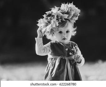 The charming girl has a wreath