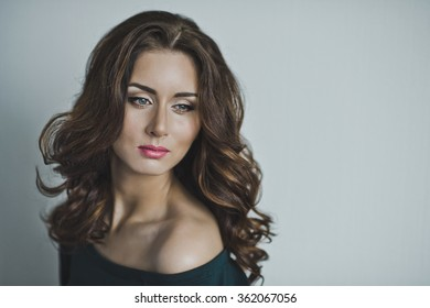 Charming girl with makeup and hairstyle.