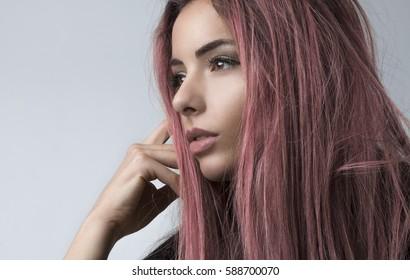 Charming girl with pink hair, closeup, studio shot,