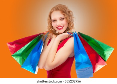 Charming girl with purchases, isolated on white background.