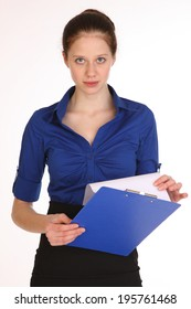 Charming girl secretary. Beautiful playful office girl with a blue folder.