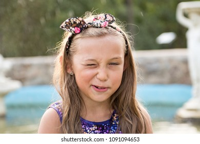 Charming girl shows a funny grimace