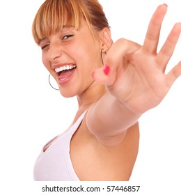 Charming girl shows OK and laughs, it is isolated on white background.