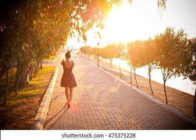 The charming girl walking along street