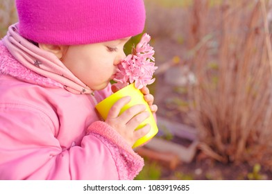 Charming girl watering flowers from watering can