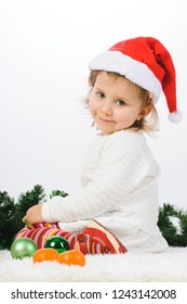 charming girl in white dress and santa hat