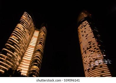 Charming golden building lights during the night, Abu-Dhabi, United Arab Emirates