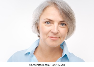 Charming grey-haired woman smiling at the camera