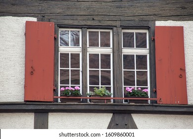 Charming Historic Building Windows, Shutters and Flower Window Boxes in Basel, Switzerland, May 31, 2019