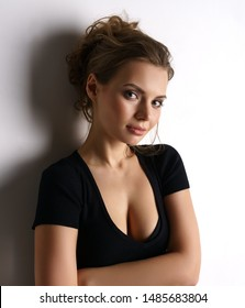Charming lady in black dress with neckline