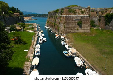 Charming landscape with the old fortress and canal with boats in Kerkira (Kepcipa), Corfu, Greece