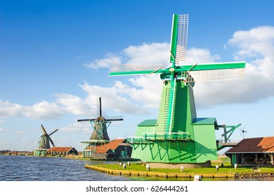 The charming landscape of ponds and windmills in Zaanse Schans, Holland, Europe against the sky