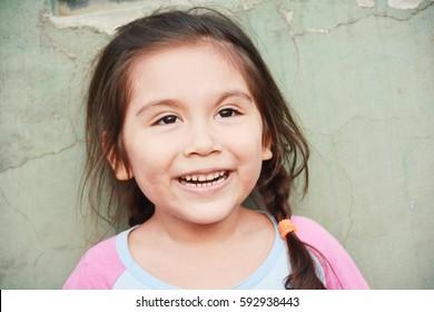Charming latin little girl smiling
