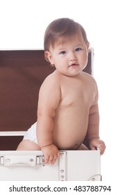Charming little baby in a suitcase on isolated white