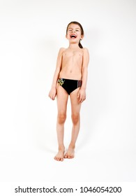 43762187aa The charming little boy in a swimming trunks isolated on a light background.