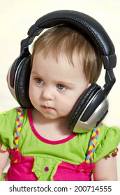 the charming little girl listens to music