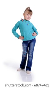 Charming little girl standing in a model pose. Isolated on the white background