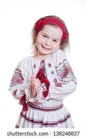 The charming little girl in the Ukrainian national dress on white isolated background