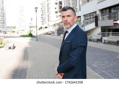 Charming male attorney possibly accountant banker executive business lawyer finance man. Single confident and handsome male businessman in blue suit and necktie with grin