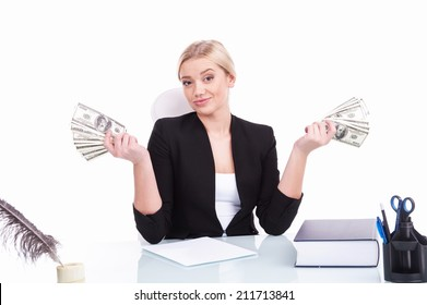 Charming mature businesswoman sitting at table. successful businesswoman holding money on white