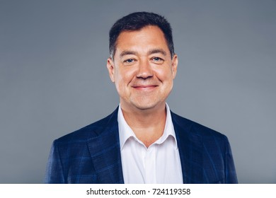 Charming Mature confident business man on suit and white shirt,dressed well studio portrait.