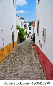 Charming medieval street of the old town Obidos in Portugal. Obidos is popular tourist destination