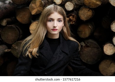 Charming model posing near the firewood