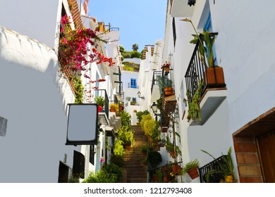 Charming narrow historic streets of white village Frigiliana in Malaga province,Andalusia,Spain