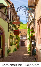 charming narrow street in Riquewihr in Alsace, France