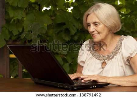 ca631585 Charming Older Woman Sitting Table Home Stock Photo (Edit Now ...