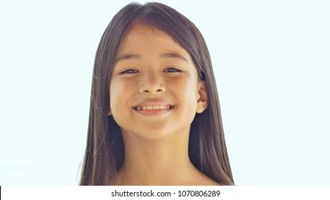 Charming philippine schoolgirl posing. Face close-up on white background nature. Summer.