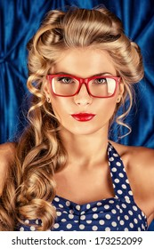 Charming pin-up woman with retro hairstyle and make-up.