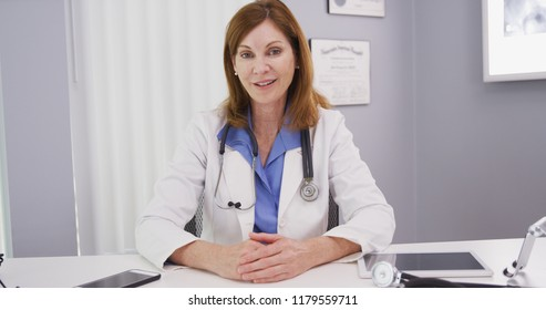 Charming portrait of professional physician talking to camera