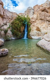 Charming small falls among stones of the dried-up desert.  The journey through the national park and reserves Ein Gedi, Israel