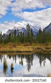 Charming small lake and picturesque autumn coast in Canada