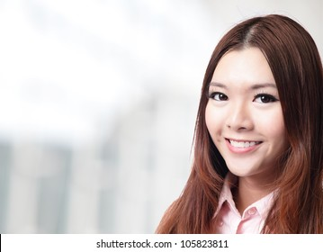 charming smile face close up of a beautiful business woman at office, model is a asian beauty
