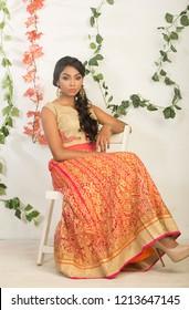 charming smiling indian woman in salwar, indoor lighting