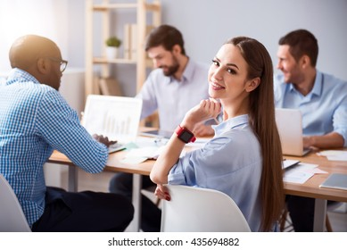 Charming smiling woman working in the office