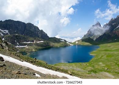 Charming smooth Tobavarchxili Lake in Georgian mountains